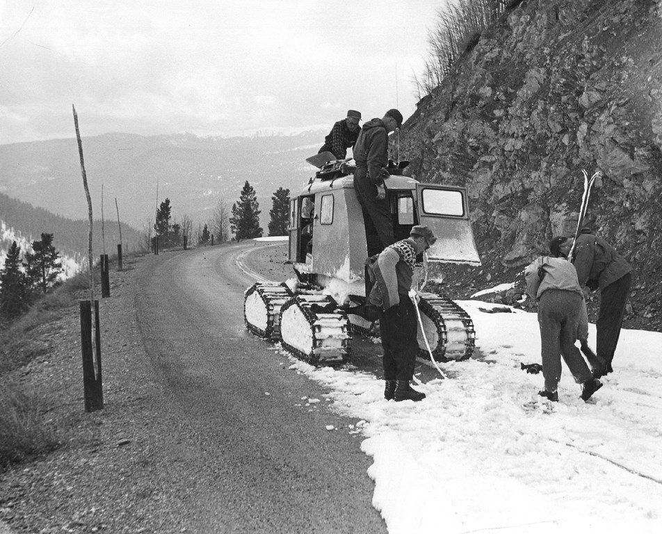 . Snow measuring crew loads skis back into the Sno-Cat where snow cover runs out near bottom of Trail Ridge Road on their return trip in 1960. (Denver Post Library photo archive)