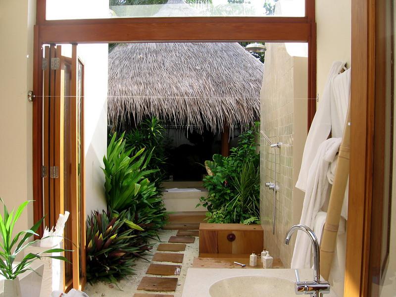 "the outdoor bathroom, leading to the bathtub ""hut"""