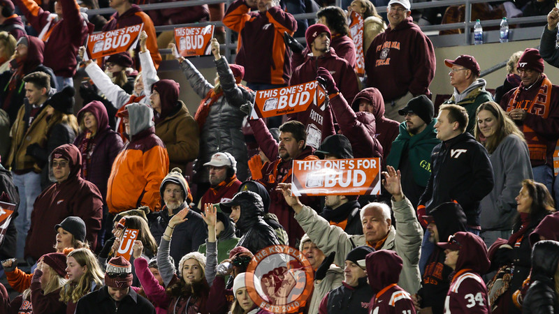 Fans hold up signs honoring defensive coordinator Bud Foster. (Mark Umansky/TheKeyPlay.com)