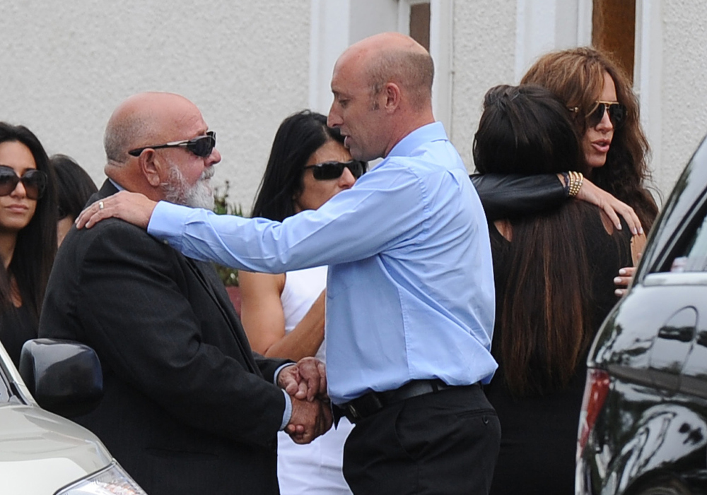 ". Father of the late South African model Reeva Steenkamp Barry Steenkamp (2L) arrives at the crematorium building in Port Elizabeth on February 19, 2013 after Steenkamp, 29, was shot four times in the early hours of February 14, by a 9mm pistol owned by South African sporting hero Oscar Pistorius. South African prosecutors on Tuesday told a bail hearing that Oscar Pistorius was guilty of ""premeditated murder\"" in the Valentine\'s Day killing of his model girlfriend at his upscale home. ALEXANDER JOE/AFP/Getty Images"