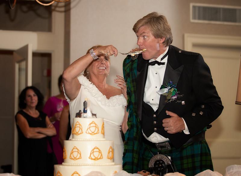 Bride Feeding Cake to Groom.jpg