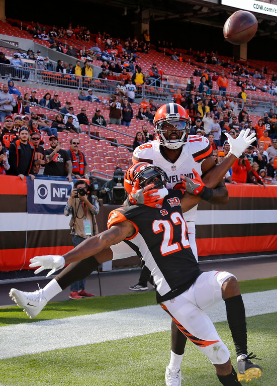 . Cincinnati Bengals cornerback William Jackson (22) breaks top a pass intended for Cleveland Browns wide receiver Kenny Britt (18) in the second half of an NFL football game, Sunday, Oct. 1, 2017, in Cleveland. (AP Photo/Ron Schwane)