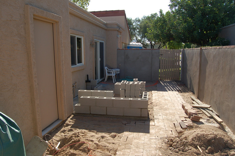 Meanwhile, in the side yard, the outdoor kitchen is being built. The wall has already been stuccoed and painted and trimmed out in brick (in the previous photo, as well).