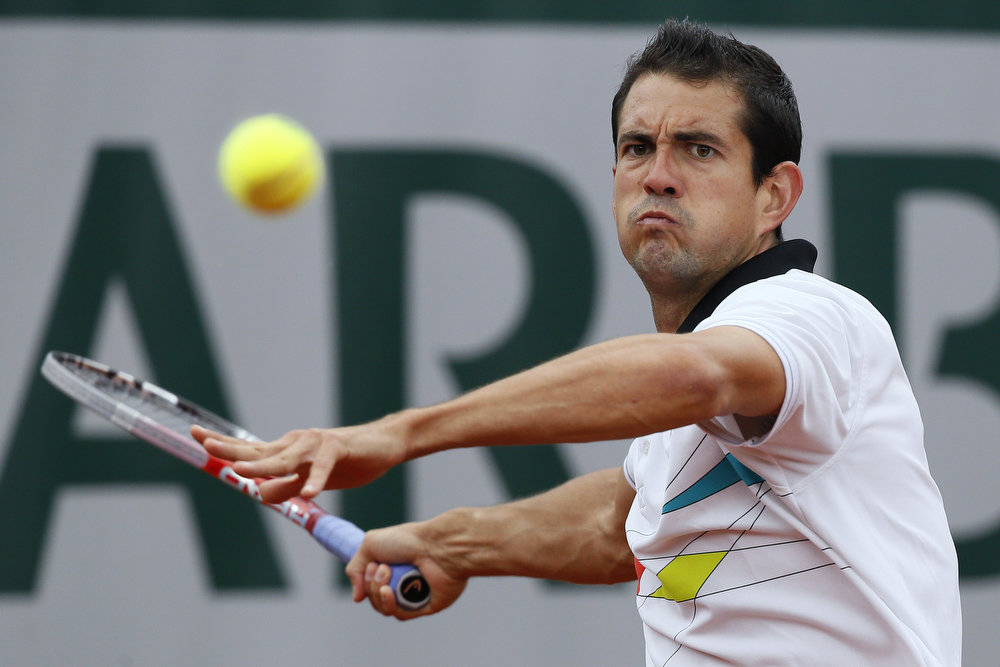 . Spain\'s Guillermo Garcia-Lopez returns to USA\'s Jack Sock during their French Tennis Open first round match at the Roland Garros stadium in Paris, on May 28, 2013.  KENZO TRIBOUILLARD/AFP/Getty Images