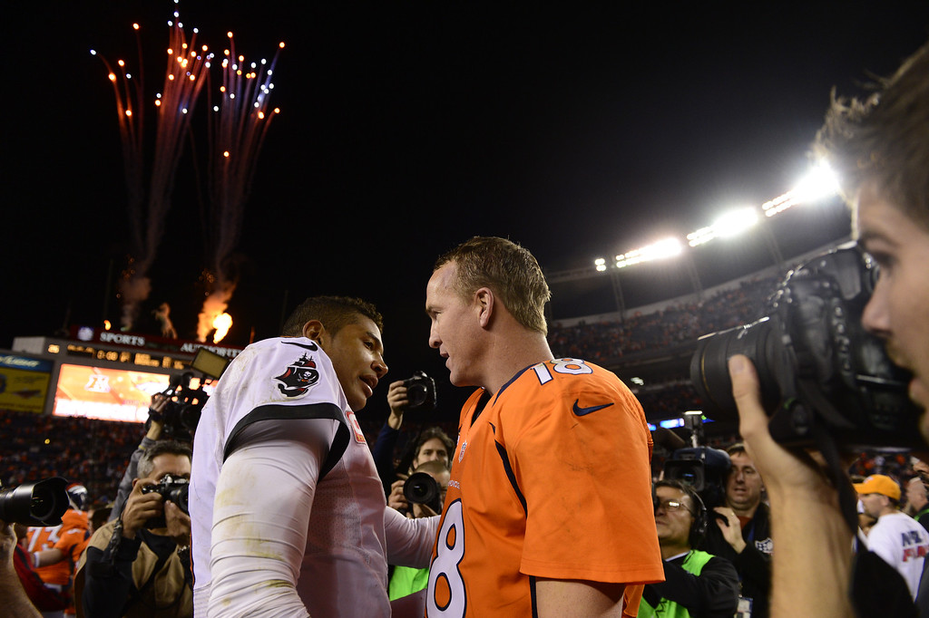 . Denver Broncos quarterback Peyton Manning #18 talks with Tampa Bay Buccaneers quarterback Josh Freeman #5 as they walk off the field.  The Denver Broncos vs The Tampa Bay Buccaneers at Sports Authority Field Sunday December 2, 2012. AAron  Ontiveroz, The Denver Post