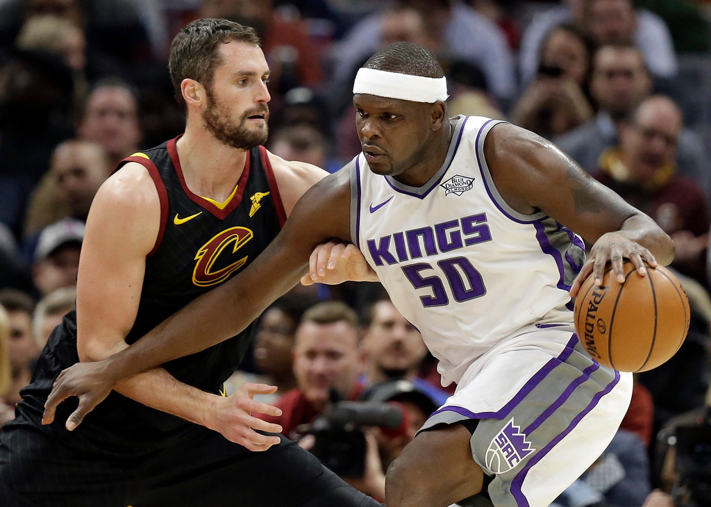 . Sacramento Kings\' Zach Randolph, right, drives past Cleveland Cavaliers\' Kevin Love in the first half of an NBA basketball game, Wednesday, Dec. 6, 2017, in Cleveland. (AP Photo/Tony Dejak)