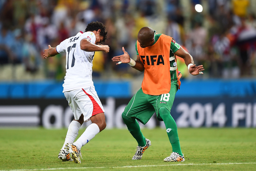 . Yeltsin Tejeda (L) and Patrick Pemberton of Costa Rica celebrate after defeating Uruguay 3-1 during the 2014 FIFA World Cup Brazil Group D match between Uruguay and Costa Rica at Castelao on June 14, 2014 in Fortaleza, Brazil.  (Photo by Laurence Griffiths/Getty Images)