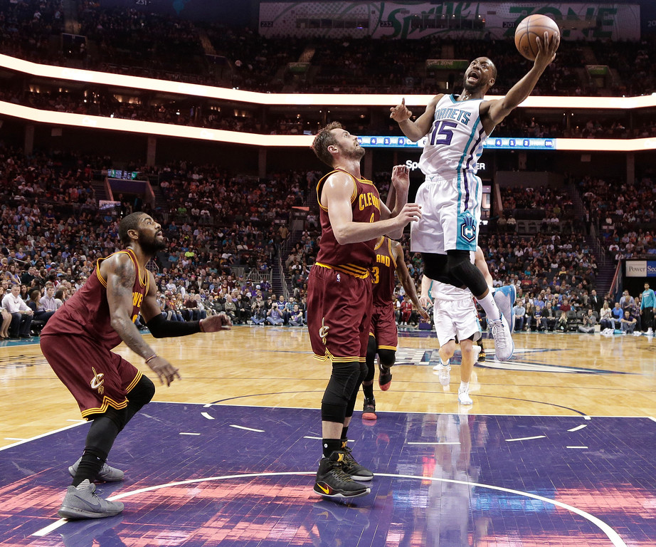 . Charlotte Hornets\' Kemba Walker (15) drives against Cleveland Cavaliers\' Kevin Love (0) during the second half of an NBA basketball game in Charlotte, N.C., Friday, March 24, 2017. The Cavaliers won 112-105. (AP Photo/Chuck Burton)