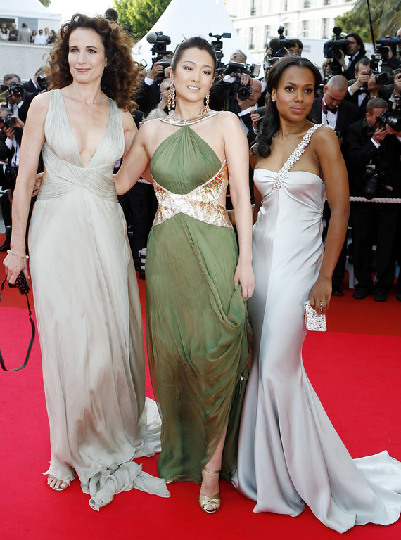 ". American actress Andie MacDowell, left, Chinese actress Gong Li, center, and American actress Kerry Washington arrive for the screening of the film ""My Blueberry Nights,\"" at the 60th International film festival in Cannes, southern France, on Wednesday, May 16, 2007.. (AP Photo/Andrew Medichini)"