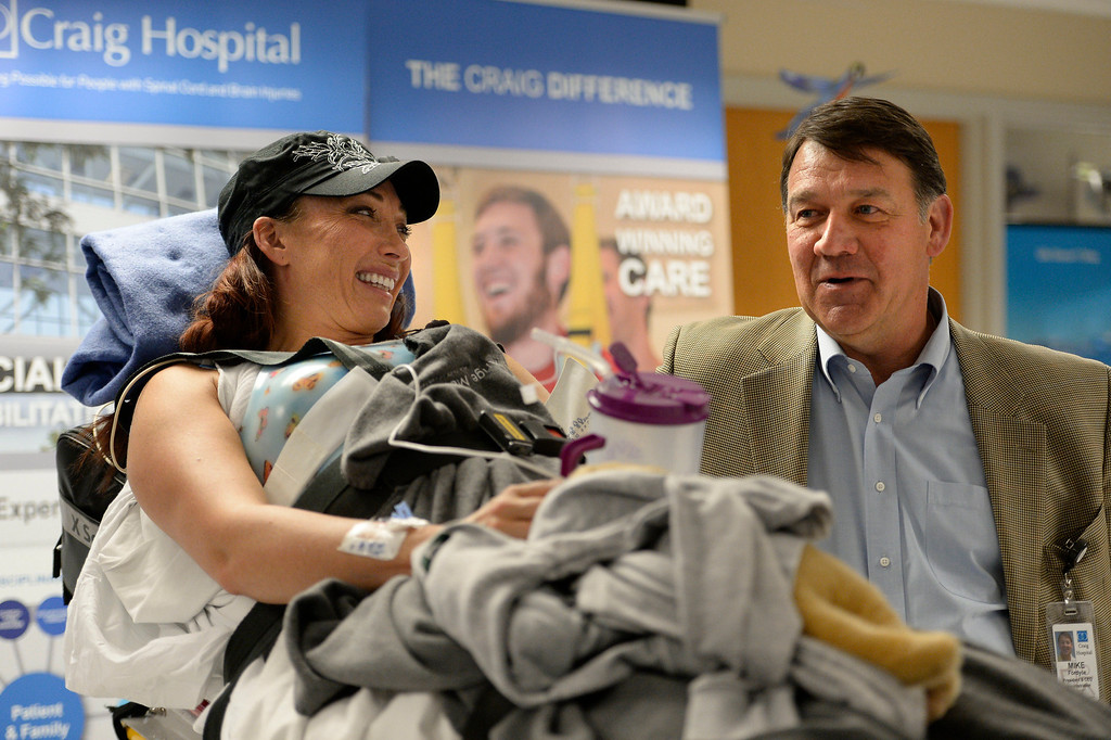 . Mike Fordyce President & CEO Administration Craig Hospital chats with Amy Van Dyken-Rouen before her small press conference after arriving at Craig Hospital from Scottsdale Healthcare Osborne Medical Center June 18, 2014 by Angel MedFlight.  (Photo by John Leyba/The Denver Post)