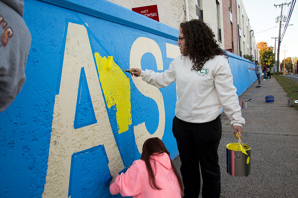 10/15/19 Wesley Bunnell | StaffrrCCSU art students spent part of Tuesday painting on East St near East Main St as part of a course called Art in Community taught by art professor Ted Efremoff. Student Karissa McFaline paints between the EASTSIDE letters.