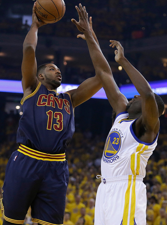 . Cleveland Cavaliers center Tristan Thompson (13) shoots against Golden State Warriors forward Draymond Green (23) during the first half of Game 1 of basketball\'s NBA Finals in Oakland, Calif., Thursday, June 4, 2015. (AP Photo/Ben Margot)