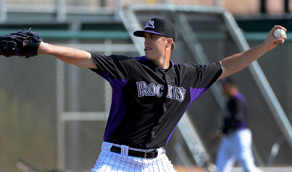 . SCOTTSDALE, AZ. - FEBRUARY 19: Colorado Rockies Drew Pomeranz (13) pitches during team fundamental February 19, 2013 in Scottsdale. (Photo By John Leyba/The Denver Post)