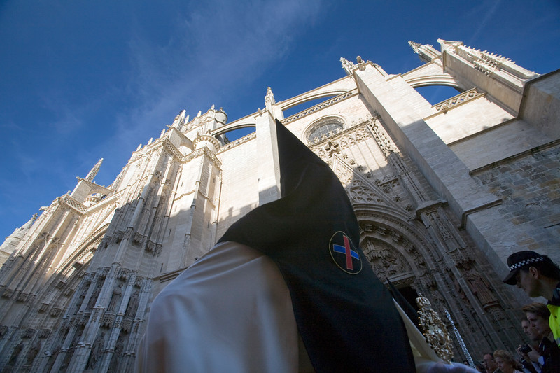 Hooded penitent in front of San Miguel gate, Seville's Cathedral, Holy Week 2008