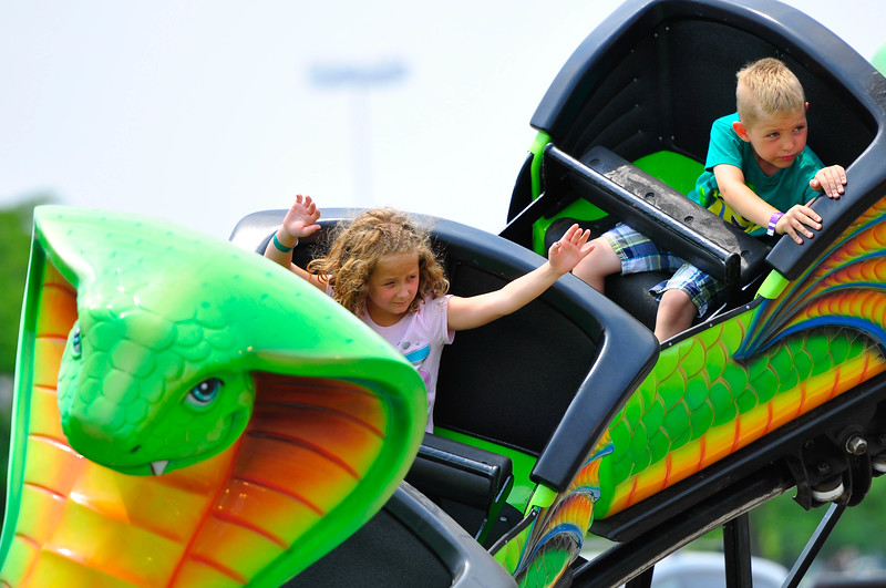 Maddie Iles (7), of Tinley Park, sits in the front car of the Cobra Rollercoaster at Oak Fest. Sunday, July 5th, 2015, in Oak Forest. (Gary Middendorf-Daily Southtown)