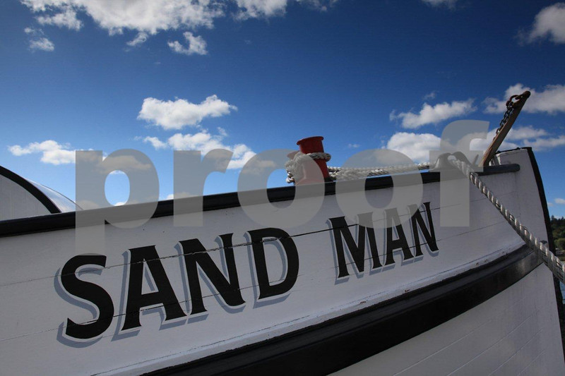 A historic 60-foot long Sandman tug boat built in 1910 and moored in Olypmia, WA .
