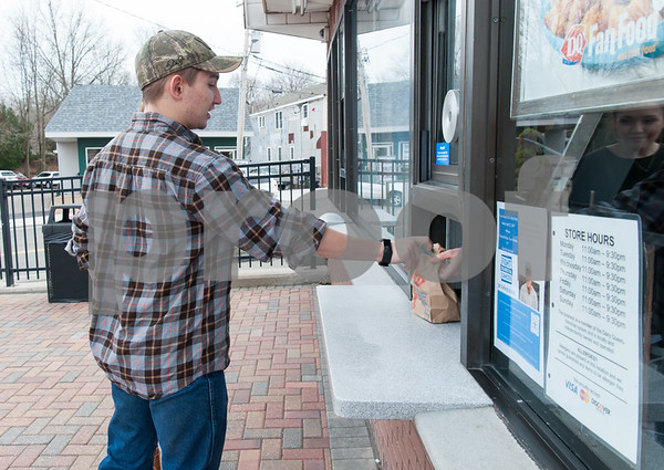 03/01/18 Wesley Bunnell   Staff Berlin High School student Richard Scalora is handed his order at Dairy Queen in Kensington on its first day of business for 2018 on Thursday.