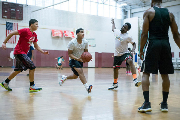 07/19/19 Wesley Bunnell | Staff Players take part in a pick up basketball game on Friday July 19, 2019 at New Britain High School. Midnight Basketball, part of the NB PAL program, is holding basketball at NBHS every Friday from 6pm -12pm and Saturdays at Osgood Park under the supervision of a NB police officer.