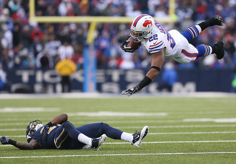 . Fred Jackson #22 of the Buffalo Bills is sent flying on a tackle by Quintin Mikell #27 of the St. Louis Rams during an NFL game at Ralph Wilson Stadium on December 9, 2012 in Orchard Park, New York. (Photo by Tom Szczerbowski/Getty Images)