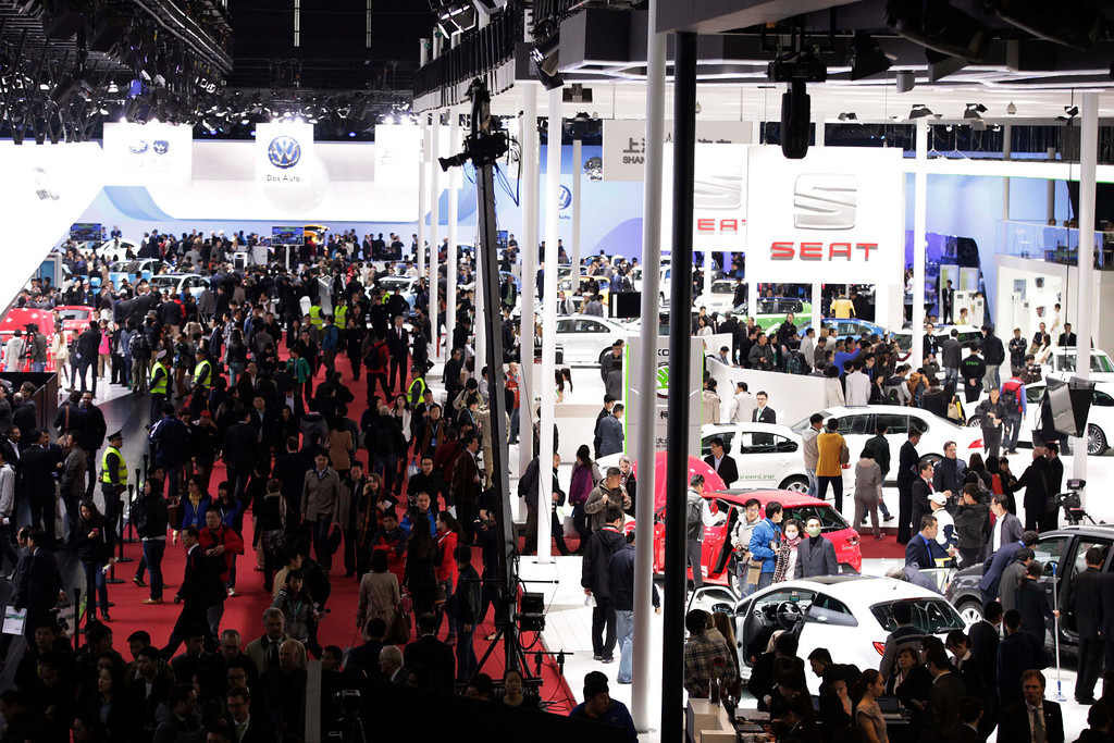 . Guests stroll during the Shanghai International Automobile Industry Exhibition (AUTO Shanghai) media day in Shanghai, China Saturday, April 20, 2013. (AP Photo/Eugene Hoshiko)