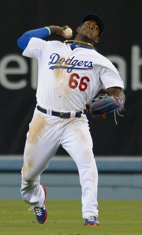 . Yasiel Puig makes a throw in the 9th inning. The Dodgers defeated the San Diego Padres 8-6 at Dodger Stadium. Los Angeles, CA. 8/19/2014(Photo by John McCoy Daily News)