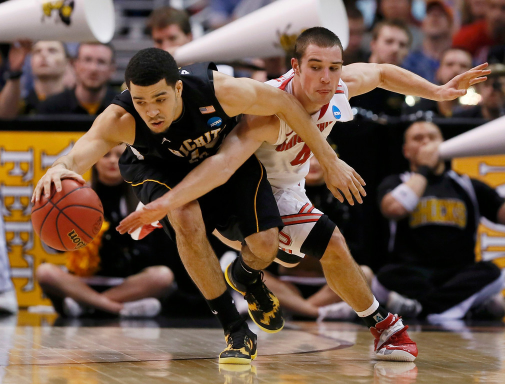 . Ohio State Buckeyes guard Aaron Craft (4) reaches in on Wichita State Shockers guard Fred Van Vleet (23) in the second half during their West Regional NCAA men\'s basketball game in Los Angeles, California March 30, 2013. REUTERS/Lucy Nicholson