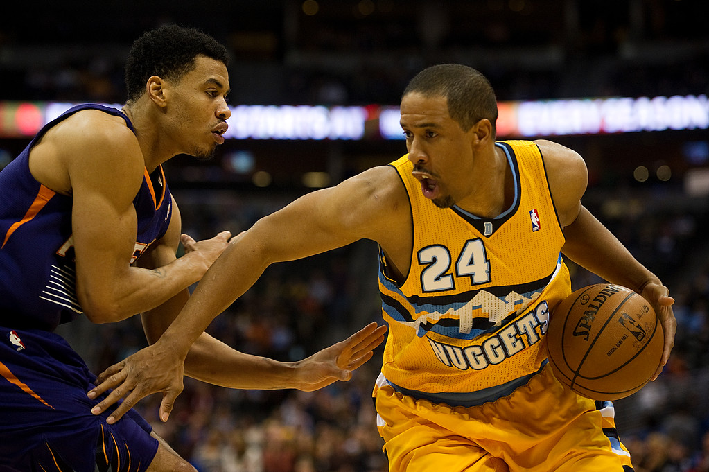 . DENVER, CO - DECEMBER 20: Andre Miller #24 of the Denver Nuggets drives around Gerald Green #14 of the Phoenix Suns during the second quarter of an NBA game at the Pepsi Center on December 20, 2013, in Denver, Colorado. (Photo by Daniel Petty/The Denver Post)