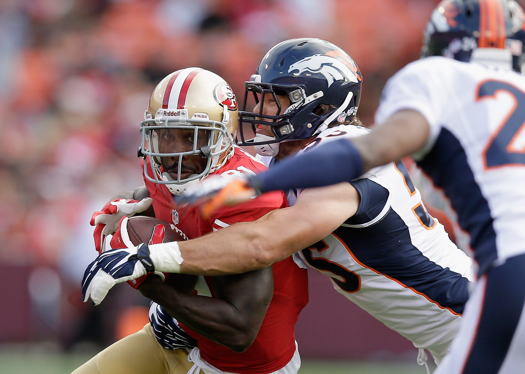 . Anquan Boldin #81 of the San Francisco 49ers is tackled by Stewart Bradley #55 of the Denver Broncos during their preseason NFL game at Candlestick Park on August 8, 2013 in San Francisco, California.  (Photo by Ezra Shaw/Getty Images)