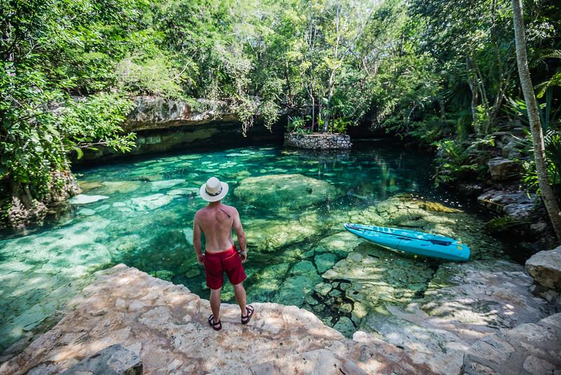 David Stock Jr of Divergent Travelers Adventure Travel blog exploring cenotes in Mexico