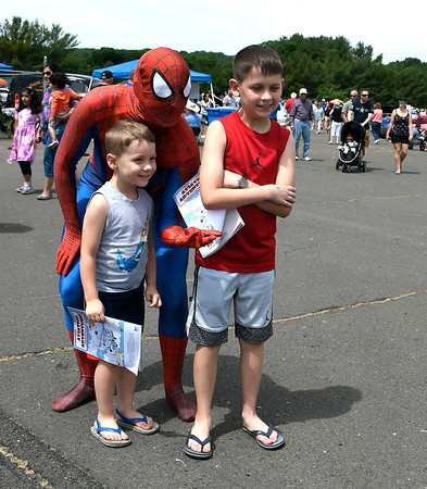6/9/2018 Mike Orazzi | Staff Adam and Tomasz Buganski pose with Spiderman during the 7th Annual Fly-In Car Show held at Robertson Airport in Plainville Saturday.