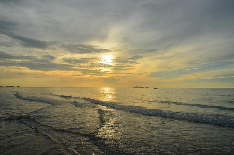 Tropical yellow sunrise seascape, Thailand.