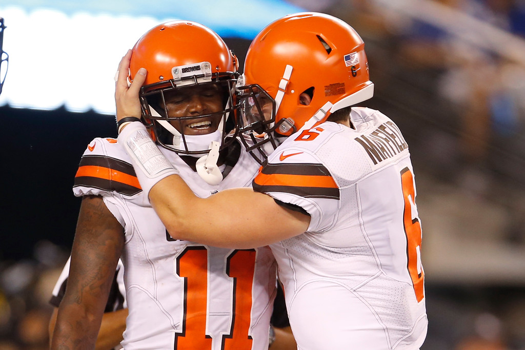 . Cleveland Browns quarterback Baker Mayfield (6) celebrates with Antonio Callaway (11) after they connected for a touchdown during the second half of a preseason NFL football game against the New York Giants Thursday, Aug. 9, 2018, in East Rutherford, N.J. (AP Photo/Adam Hunger)