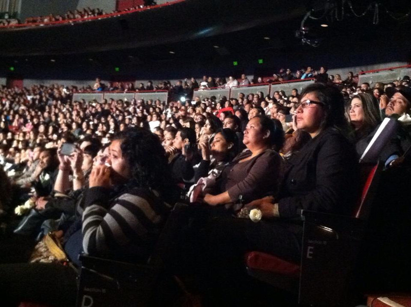 . Fans watch a video montage of Jenni Rivera at the singer\'s memorial sevice on Dec. 19, 2012, at Gibson Amphitheatre in Universal City. (Mariecar Mendoza/Staff)