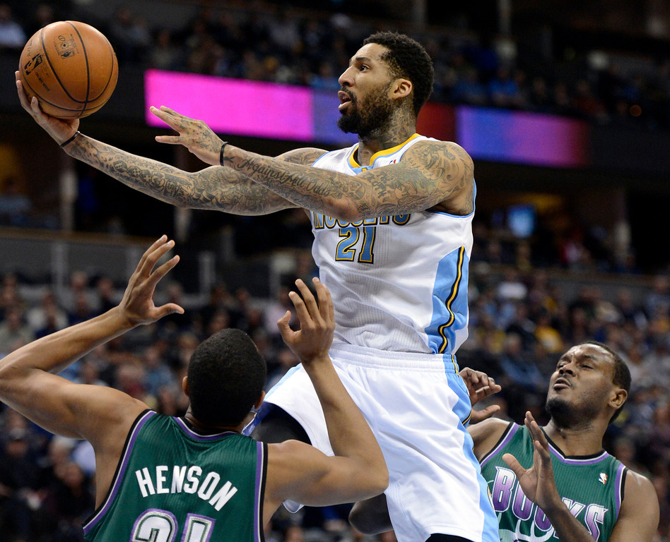 . DENVER, CO. - FEBRUARY 05: Wilson Chandler (21) of the Denver Nuggets drives to the basket as John Henson (31) of the Milwaukee Bucks blocks it during the first quarter February 05, 2013 at Pepsi Center. The Denver Nuggets take on the Milwaukee Bucks in NBA action. (Photo By John Leyba/The Denver Post)