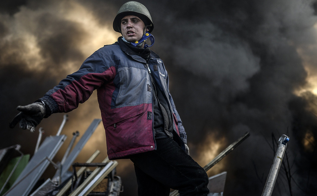 . A protestor builds a barricade early in the morning on February 21, 2014 at the Independent square in Kiev. AFP PHOTO / BULENT KILIC/AFP/Getty Images