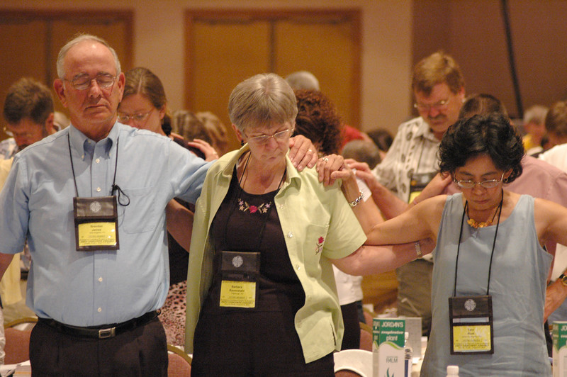 The Rev. Dr. Bob Edgar, General Secretary of the National Council of Churches, asked the Voting Members to pray for Christian unity and touch the shoulder of the persons around them