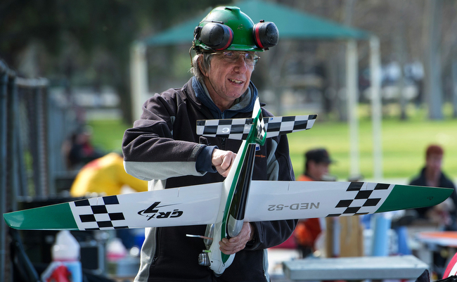 Description of . Rob Metkemeyer of the Netherlands prepares his plane for practice flights.  The San Gabriel Valley Radio Control League members fly their planes at Whittier Narrows Recreation Area Feb. 21, 2013 practicing for the upcoming Basin Q40 Classic pylon racing event at Apollo Field in the Sepulveda Basin this weekend.  (SGVN/Staff photo by Leo Jarzomb)
