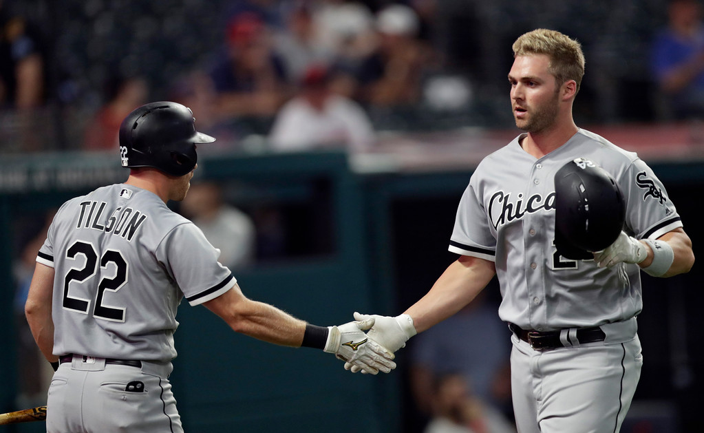 . Chicago White Sox\'s Matt Davidson, right, is congratulated by Charlie Tilson after Davidson hit a solo home run in the ninth inning of a baseball game, Monday, June 18, 2018, in Cleveland. The Indians won 6-2. (AP Photo/Tony Dejak)