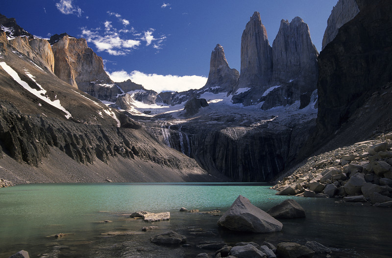 Torres del Paine - Chile  On the southeastern edge of the Andes lies the granite towers of Torres del Paine. At the head of the Ascencio Valley is this opaque bottle-green tarn, with the tooth-like Paine Grande (2884m) towering over it all.