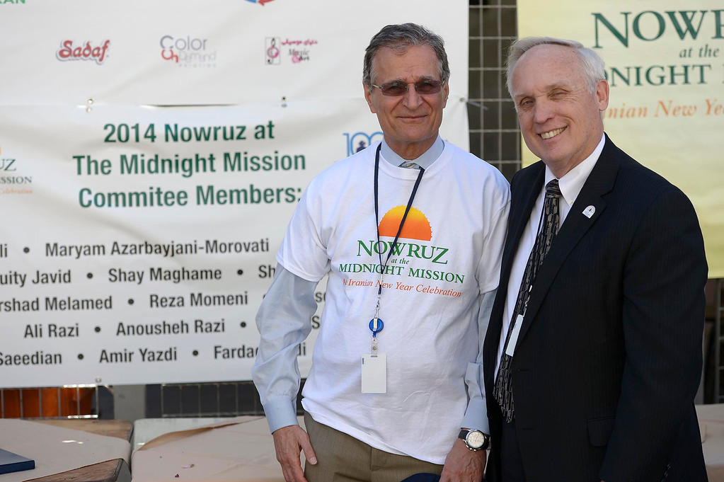 . (l-r) Ali Razi, Vice Chair and Midnight Mission President Larry Adamson, The Midnight Mission is celebrating its 100th anniversary this year. As part of the yearlong festivities, the Persian community is helping the Midnight Mission celebrate by sharing Persian New Year or Nowruz. Volunteers at the event served a traditional Persian meal to the homeless in the middle of 6th Street and San Pedro. Los Angeles, CA. March 14, 2014 (Photo by John McCoy / Los Angeles Daily News)