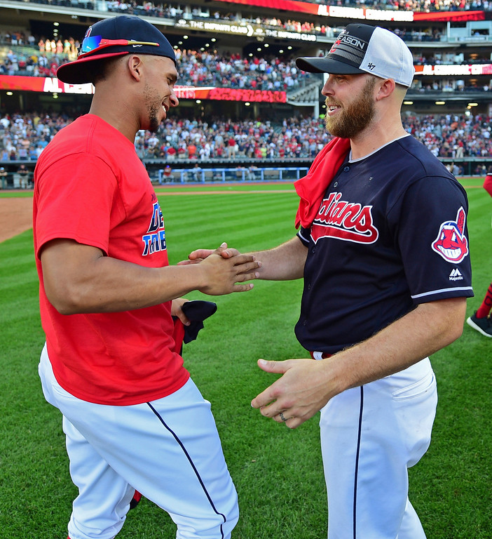 . Cleveland Indians relief pitcher Cody Allen, right, celebrates with Michael Brantley after the Indians defeated the Detroit Tigers 15-0 to clinch the American League Central Division, in a baseball game, Saturday, Sept. 15, 2018, in Cleveland. (AP Photo/David Dermer)