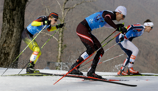 . Germany\'s Fabian Riessle, Austria\'s Mario Stecher and Norway\'s Joergen Graabak, from left, compete during the cross-country portion of the Nordic combined Gundersen large hill team competition at the 2014 Winter Olympics, Thursday, Feb. 20, 2014, in Krasnaya Polyana, Russia. (AP Photo/Kirsty Wigglesworth)