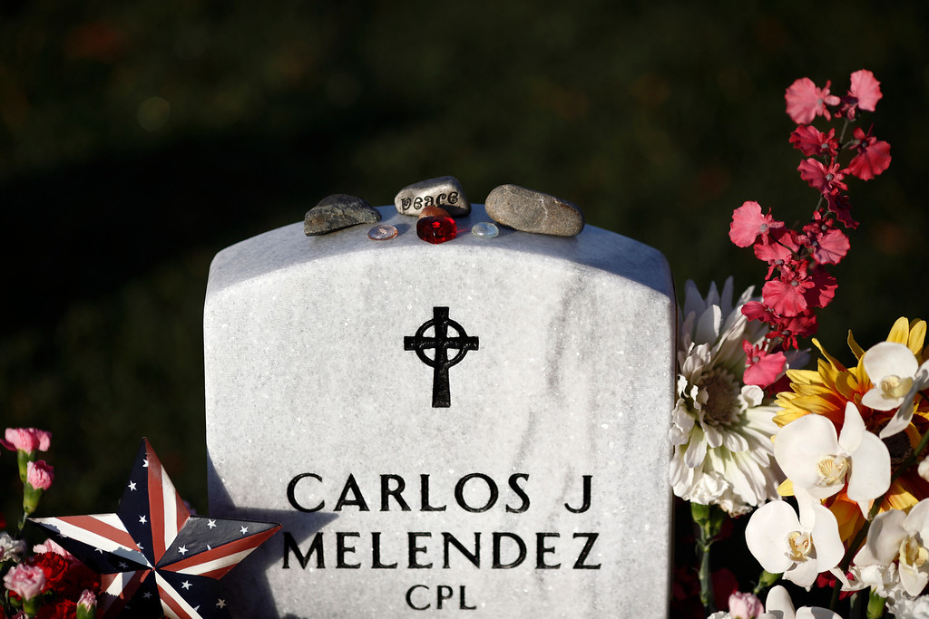 . Stones and pebbles on the gravestone of Marine Cpl. Carlos Melendez, who died in Iraq on Dec. 19, 2011, in section 60 of Arlington National Cemetery on Memorial Day in Arlington, Va., May 28, 2012. (Luke Sharrett/The New York Times)