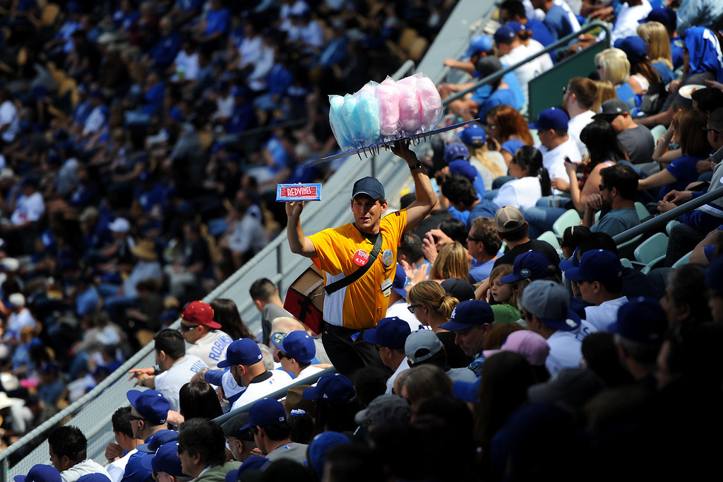 . Vendor hawks cotton candy at the Dodgers home opener, Friday, April 4, 2014, at Dodger Stadium. (Photo by Michael Owen Baker/L.A. Daily News)