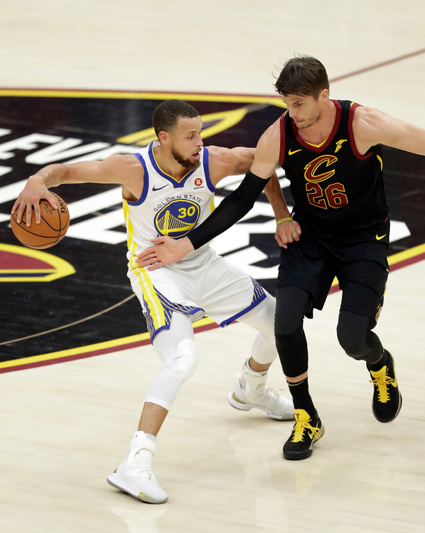 . Golden State Warriors\' Stephen Curry is defended by Cleveland Cavaliers\' Kyle Korver during the first half of Game 4 of basketball\'s NBA Finals, Friday, June 8, 2018, in Cleveland. (AP Photo/Tony Dejak)