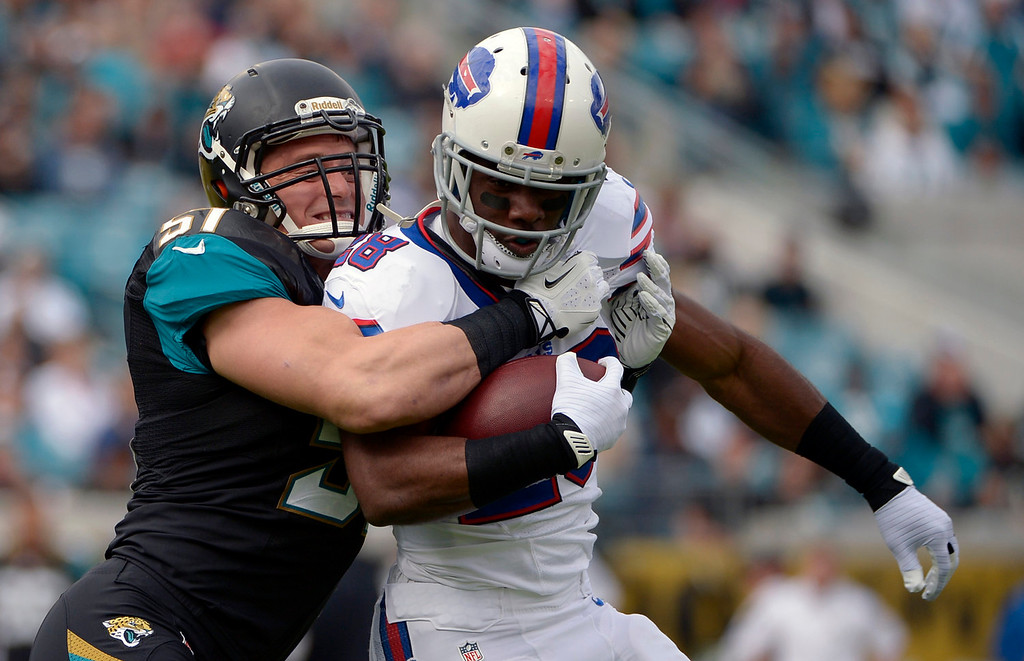 . Jacksonville Jaguars middle linebacker Paul Posluszny (51) stops Buffalo Bills running back C.J. Spiller after a short gain during the first half of an NFL football game in Jacksonville, Fla., Sunday, Dec. 15, 2013. (AP Photo/Phelan M. Ebenhack)