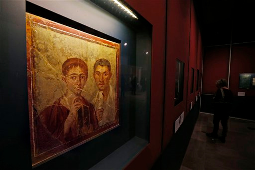 . A fresco showing the baker Terentius Neo and his wife, found in the ruins of Pompeii, is seen during a photo call for the upcoming exhibition entitled \'Life and death Pompeii and Herculaneum\', at the British Museum in central London, Tuesday, March 26, 2013. The exhibition about the two Roman cities, buried by a catastrophic volcanic eruption of Mount Vezuvius in 79 AD, will run at the museum from March 28 to Sept. 29, 2013. (AP Photo/Lefteris Pitarakis)