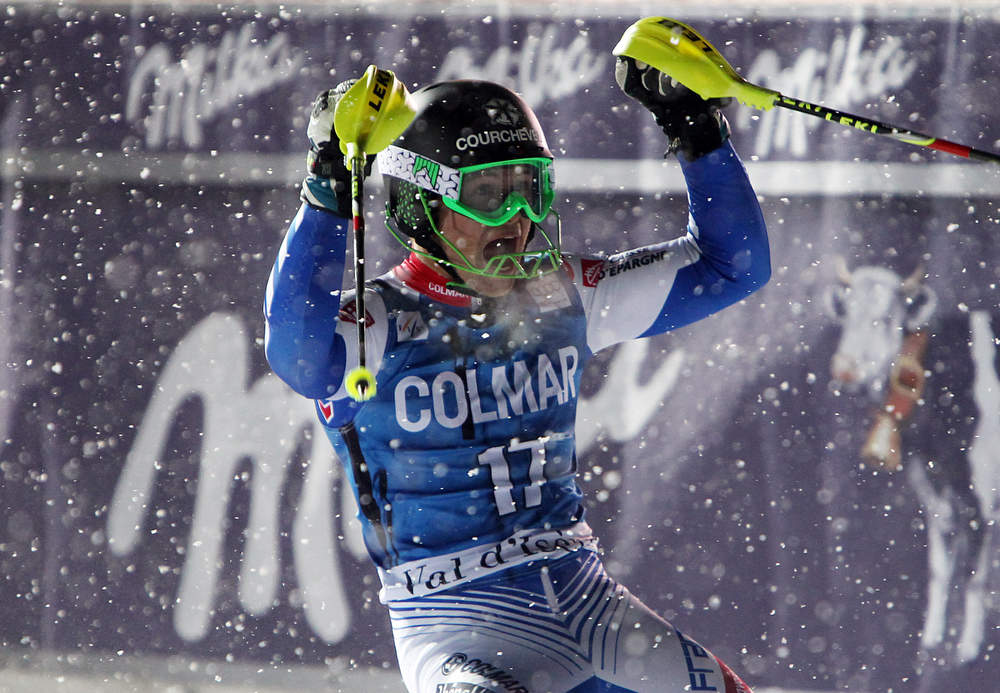 Description of . France's Alexis Pinturault reacts at finish line after winning an alpine ski, men's World Cup slalom in Val d'Isere, France, Saturday, Dec. 8, 2012. (AP Photo/Alessandro Trovati)