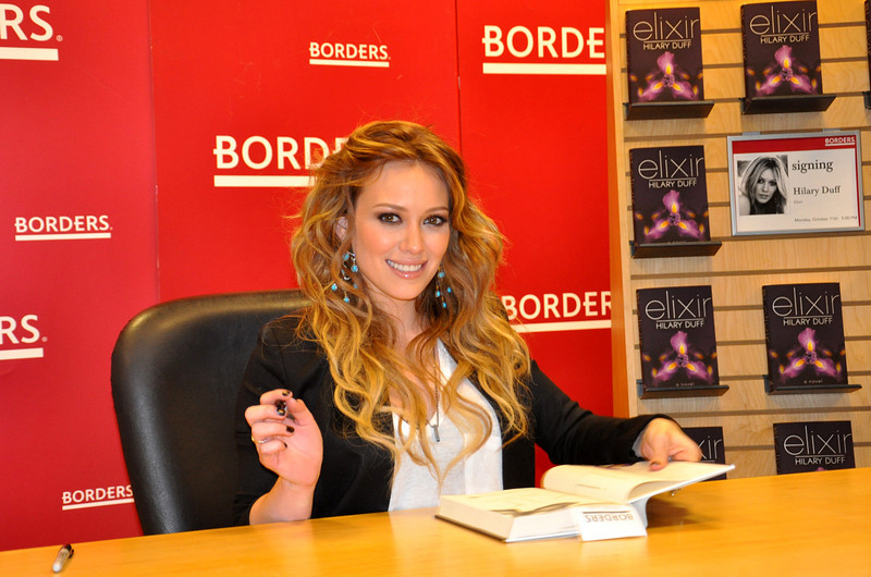 Celebrity, Hilary Duff, autographs her new book at Borders in New York.