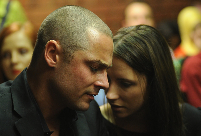 . Family members of South African Olympic sprinter Oscar Pistorius appear on February 22, 2013 at the Magistrate Court in Pretoria. Pistorius battled to secure bail as he appeared on charges of murdering his model girlfriend Reeva Steenkamp on February 14, Valentine\'s Day. South African prosecutors will argue that Pistorius is guilty of premeditated murder in Steenkamp\'s death, a charge which could carry a life sentence. Pistorius denies the charge, saying that he shot 29-year-old Steenkamp repeatedly through a locked bathroom door in the dead of night by accident, having mistaken her for a burglar.  ALEXANDER JOE/AFP/Getty Images